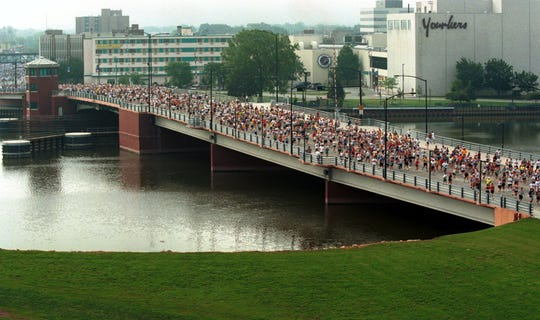 Runners in the first Cellcom Green Bay Marathon cross the Ray Nitschke Memorial Bridge on June 25, 2000, in downtown Green Bay. This year's marathon starts and finishes in the downtown for the first time since the 2003 race. The race has grown over the year and the downtown has changed, too.