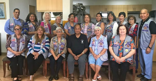 Guam Sunshine Lions Club members brought cheer, songs, and supplies to Father Gus Gumataotao at the Capuchin  Friary in Agana Heights on May 11.  Seated from left: L. Jill Pangelinan, L. LouJean Borja, L. Jovie Mejorada, Father Gus, L. Helen Mendiola, and L. Doris Cruz. Standing from left: Lions Frank Aguon, Jr., Lorraine Rivera, Lola Flores, Helen Colby, Dee Cruz, Julie Cruz, Tish Tano, Annie Artero, Marietta Camacho, Sid Weedin and Pete Babauta.
