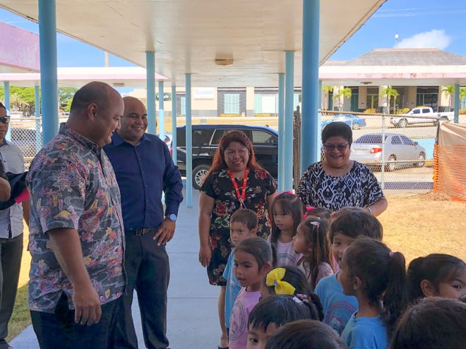 Lyndon B. Johnson Elementary School held a groundbreaking ceremony on May 15 to celebrate the long-awaited canopy repair project scheduled to be completed over the summer. Pictured: Superintendent Jon Fernandez and Acting Governor Joshua Tenorio, students, faculty and staff.