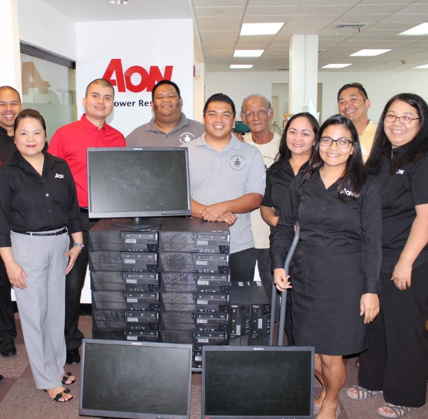 Aon Insurance donates 16 computers to Sanctuary Inc. to help build computer literacy