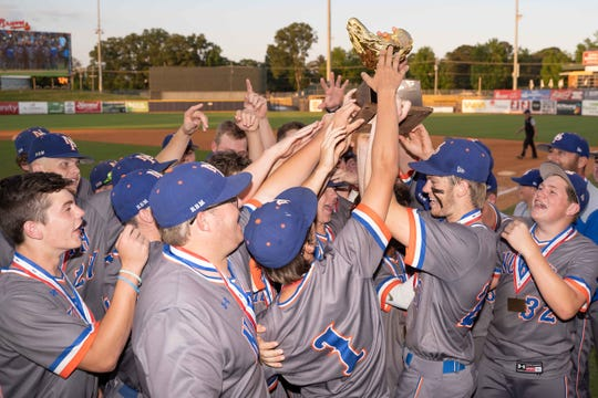 North Pontotoc players celebrate with the trophy following their 9-1 win against Magee during Game Two of the MHSAA 3A Baseball Championship held at the Trustmark Park in Pearl, MS, Wednesday May 16th, 2019.(Bob Smith)