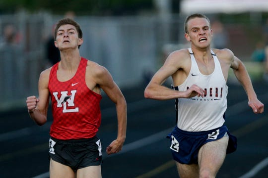 Harrison's Caleb Beimfohr and West Lafayette's Mitchell Curl compete in the 800 meter run during the IHSAA West Lafayette boys track sectionals, Thursday, May 16, 2019 in West Lafayette.