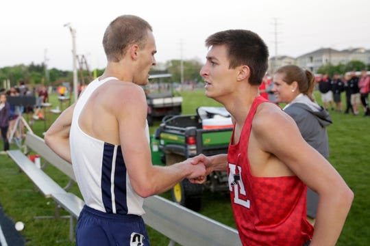 Harrison's Caleb Beimfohr and West Lafayette's Mitchell Curl shake hands after competing in the 800 meter run during the IHSAA West Lafayette boys track sectionals, Thursday, May 16, 2019 in West Lafayette.