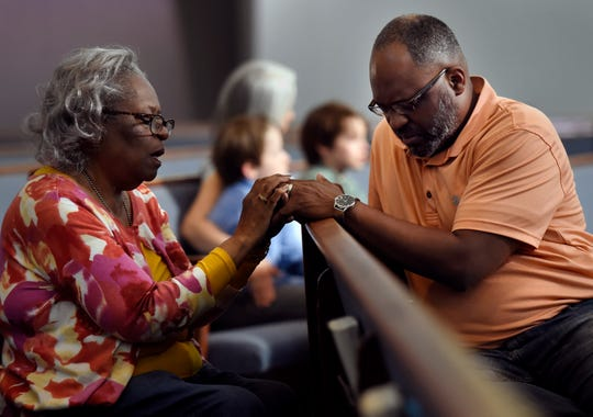 Supporters pray for Donnie Johnson during an anti-death penalty vigil at the Riverside Chapel Seventh-day Adventist Church, Thursday, May 16, 2019, in Nashville, Tenn. Donnie Johnson, who is to be executed Thursday, belonged to the church on Youngs Lane. He was sentenced to death for the 1984 murder of his wife Connie Johnson in Memphis. He suffocated her by stuffing a 30-gallon trash bag down her throat.