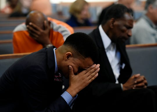 Riverside Chapel Seventh-day Adventist Church senior pastor Furman Fordham prays with other supporters of Donnie Johnson during an anti-death penalty vigil at the Riverside Chapel Seventh-day Adventist Church, Thursday, May 16, 2019, in Nashville, Tenn. Donnie Johnson, who is to be executed Thursday, belonged to the church on Youngs Lane. He was sentenced to death for the 1984 murder of his wife Connie Johnson in Memphis. He suffocated her by stuffing a 30-gallon trash bag down her throat.
