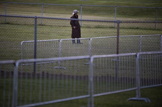 A protester in favor of the death penalty stands in a field alone during the execution of Donnie Johnson outside RIverbend Maximum Security Institution Thursday, May 16, 2019 in Nashville, Tenn. Johnson was sentenced to death for the 1984 murder of his wife Connie Johnson in Memphis.