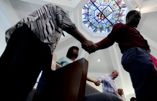 Supporters for Donnie Johnson pray during an anti-death penalty vigil at the Riverside Chapel Seventh-day Adventist Church, Thursday, May 16, 2019, in Nashville, Tenn. Donnie Johnson, who is to be executed Thursday, belonged to the church on Youngs Lane. He was sentenced to death for the 1984 murder of his wife Connie Johnson in Memphis. He suffocated her by stuffing a 30-gallon trash bag down her throat.