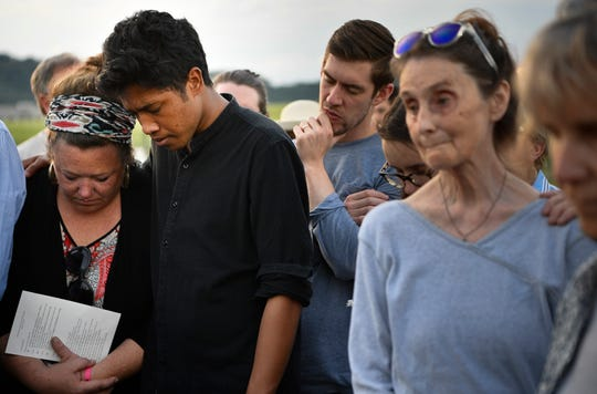 The Rev. Ingrid McIntyre is hugged by Justin Jones as they stand with protesters against the death penalty during the execution of Donnie Johnson outside Riverbend Maximum Security Institution on May 16, 2019, in Nashville.