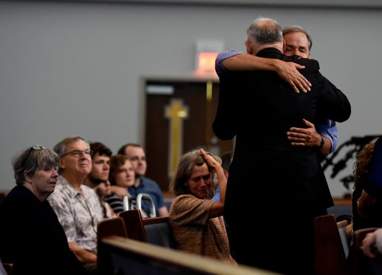 Supporters comfort each other during an anti-death penalty vigil for Donnie Johnson at the Riverside Chapel Seventh-day Adventist Church, Thursday, May 16, 2019, in Nashville, Tenn. Donnie Johnson, who is to be executed Thursday, belonged to the church on Youngs Lane. He was sentenced to death for the 1984 murder of his wife Connie Johnson in Memphis. He suffocated her by stuffing a 30-gallon trash bag down her throat.