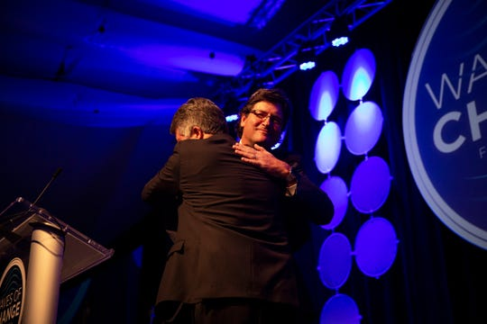 Bill Barker hugs Michael Wynn after naming him the 2019 Naples Daily News Outstanding Citizen of the Year during the Greater Naples Chamber of Commerce's annual dinner at The Ritz-Carlton Golf Resort in Naples on Thursday, May 16, 2019.