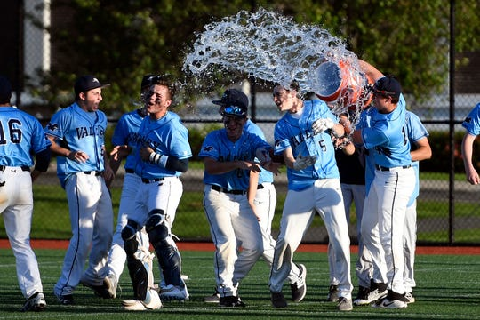 Teammates dump water on Zach Byle as Wayne Valley defeats Passaic Valley 2-1 in the Passaic County baseball championship on Thursday, May 16, 2019, in Wayne.