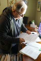 Ed Maspero looks for tax documents at his home in Murrieta, Calif., May 16, 2019. Riverside County erroneously removed Maspero's property tax break exemption, which he receives as a disabled veteran.