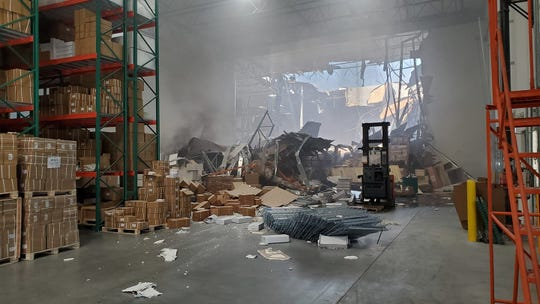 A photo of the inside of a warehouse in Riverside after an F-16 from March Air Reserve Base after it crashed into the warehouse Thursday afternoon.