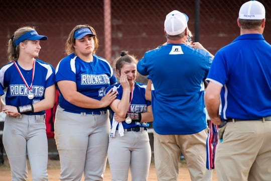 Spring Grove's Hannah Shaffer consoles teammate Olivia Lillich after the Rockets fell 3-1 to Delone Catholic in the YAIAA softball championship.