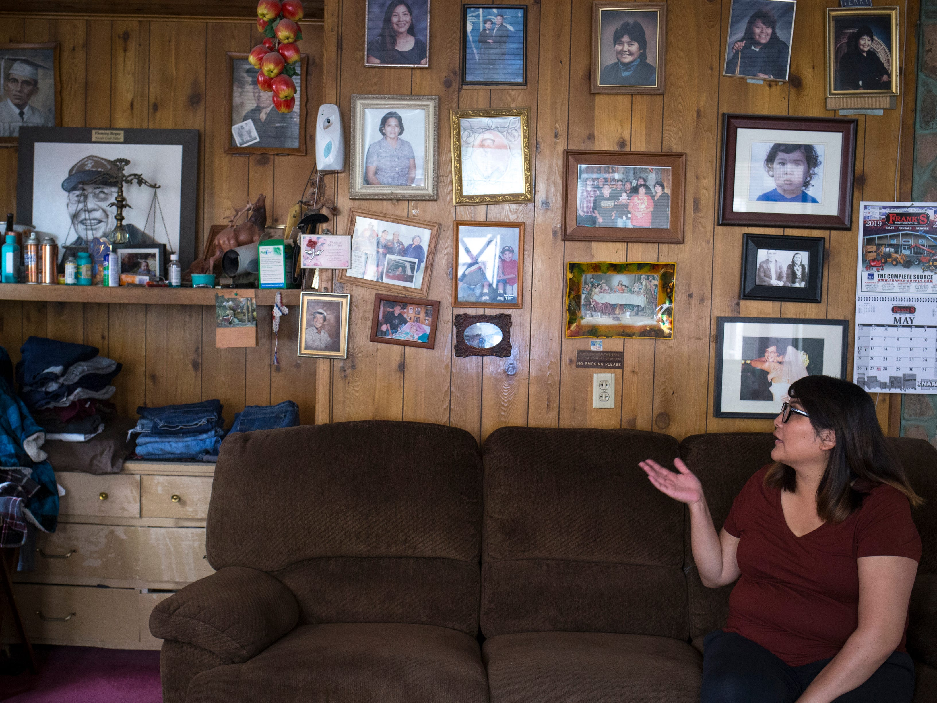 Theodosia Ott talks about her grandfather, Navajo Code Talker Fleming Begaye Sr., from the Begaye family home in Chinle, Ariz., on May 16, 2019.