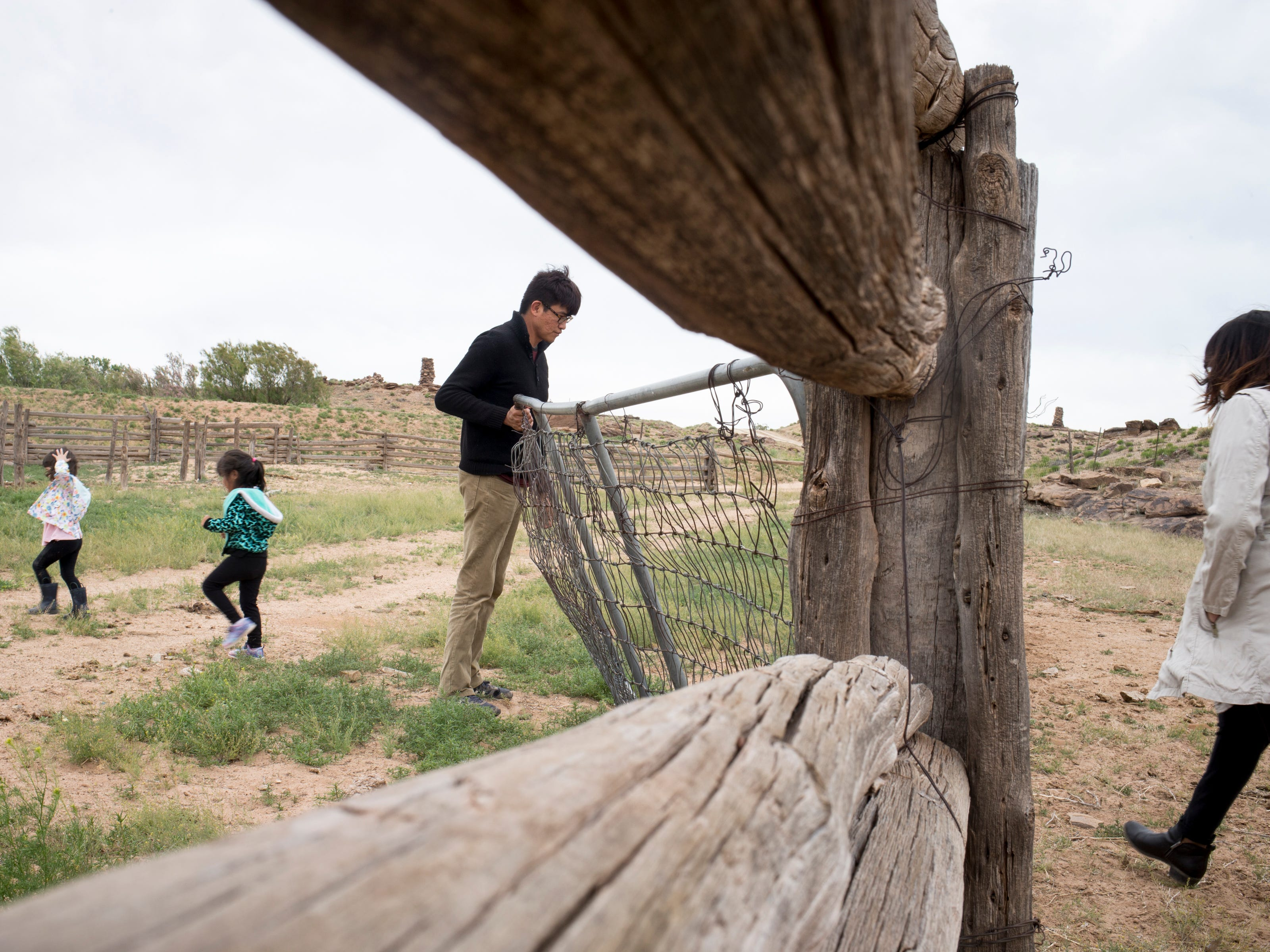 Trent Nez (grandson) opens a gate on the Begaye family farm in the Salt Water Canyon, east of Many Farms, Ariz., on May 16, 2019.