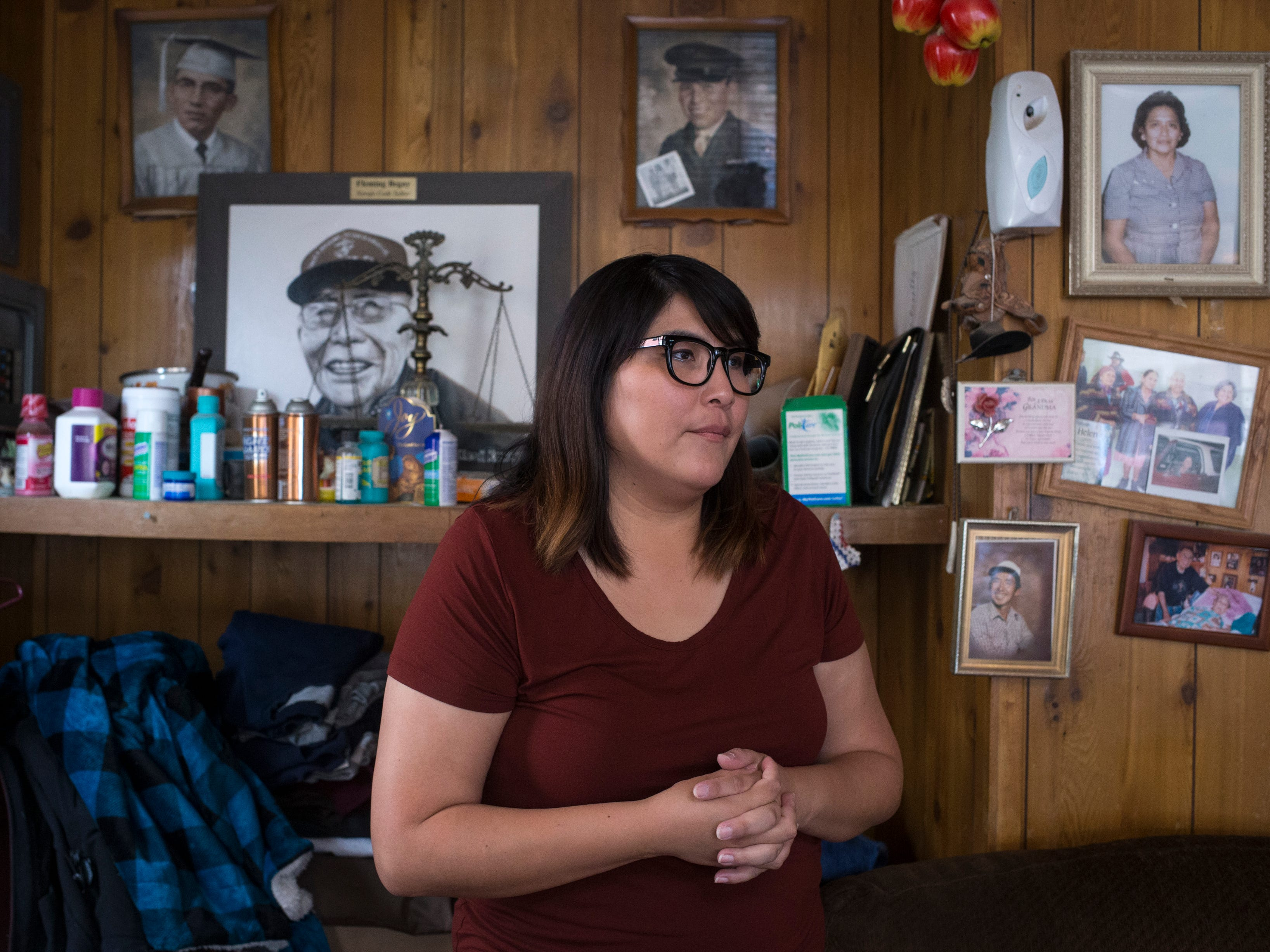 Theodosia Ott talks about her grandfather, Navajo Code Talker Fleming Begaye Sr., from the Begaye family home in Chinle, Ariz., on May 16, 2019