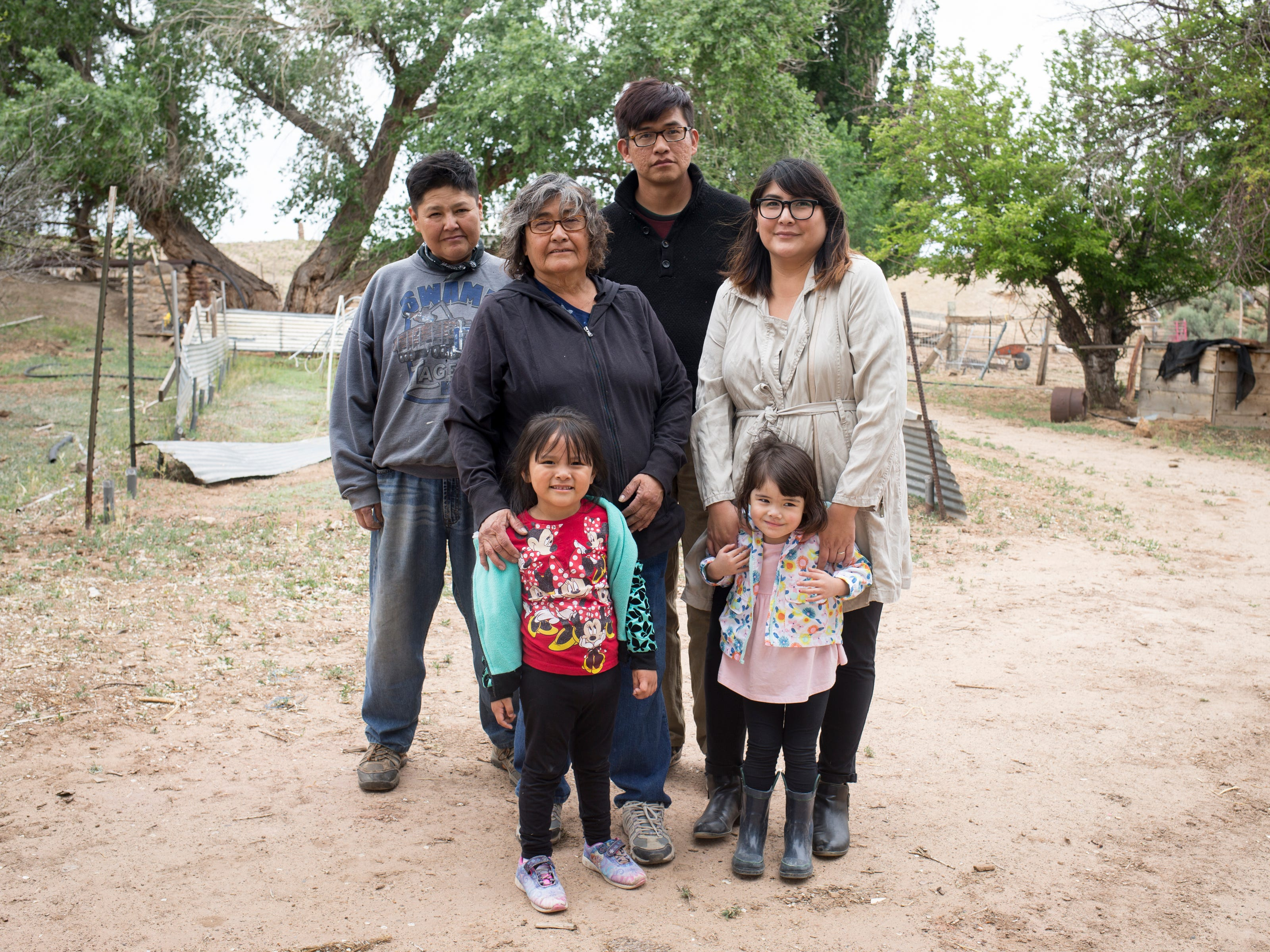 Clockwise from left: Terry Oliver (granddaughter), Veronica Walter (daughter), Trent Nez (grandson), Theodosia Ott (granddaughter), Oona Ott (great-granddaughter), and Zara Oliver (great-granddaughter) on the Begaye family farm in the Salt Water Canyon, east of Many Farms, Ariz.
