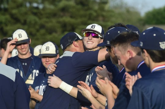Dallastown head coach Greg Kinneman hugs Dallastown third baseman Darren Sciortino after the YAIAA championship game Thursday, May 16, 2019.