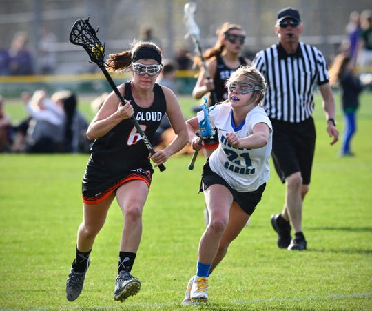St. Cloud Area's Brenna Weaver and Ava Hommerding of Sartell/Sauk Rapids battle for control of the ball during their lacrosse game Thursday, May 16, at Sauk Rapids-Rice High School.