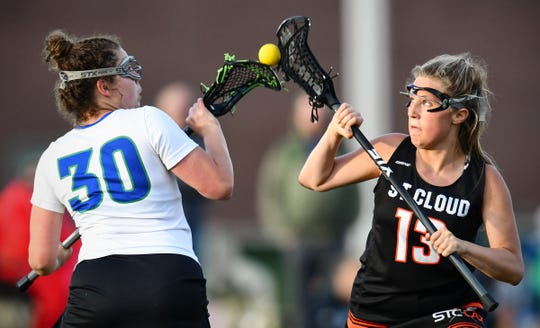 St. Cloud Area's Chloe Woodman and Ella Steinberg of Sartell/Sauk Rapids battle for control of the ball during their lacrosse game Thursday, May 16, at Sauk Rapids-Rice High School.