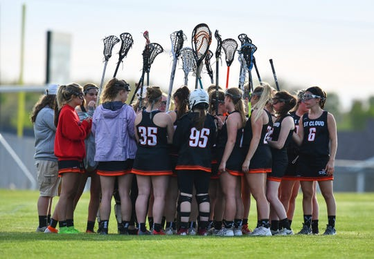 St. Cloud Area players gather at the start of the second half during their lacrosse game Thursday, May 16, at Sauk Rapids-Rice High School.