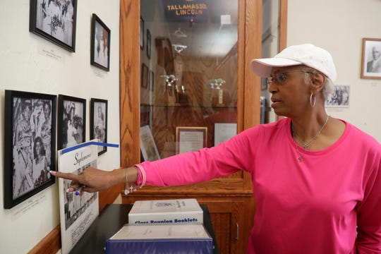 """Brenda H. Hawkins shares the names and memories of those whose photos are on display inside the Lincoln Room, a museum put together by William """"Mack"""" Rush to honor the memory of Lincoln High School, at the Lincoln Center Thursday, May 16, 2019."""