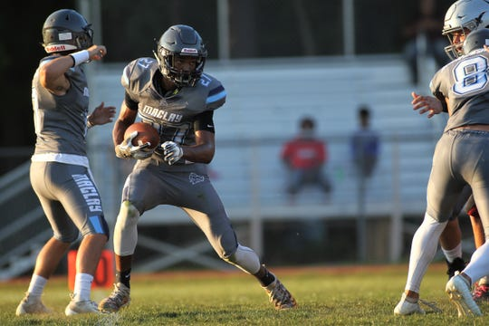 Maclay senior Robert Parker-Crawford takes a jet sweep 70 yards for a touchdown as the Marauders beat Cedar Creek Christian during a spring football game on May 16, 2019.