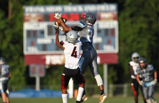 Maclay receiver Robert Parker-Crawford makes a catch above a defender as the Marauders beat Cedar Creek Christian during a spring football game on May 16, 2019.