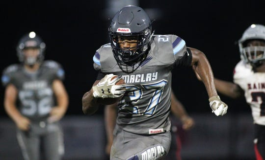 Maclay senior Robert Parker-Crawford takes off on a 40-yard touchdown run as the Marauders beat Cedar Creek Christian during a spring football game on May 16, 2019.