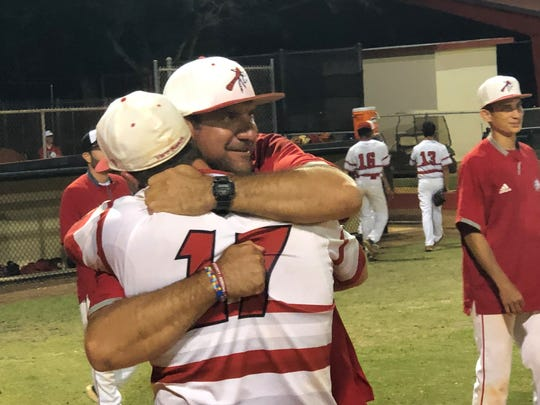 Vero Beach baseball coach Bryan Rahal hugs Nick Celidonio after their 3-1 victory over Alonso