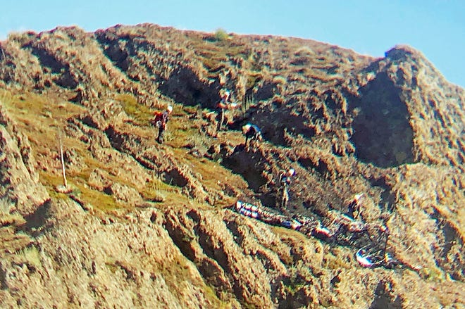This photo provided by the Santa Barbara County Sheriff's Office shows a search-and-recovery team at the scene of a small plane crash near Figueroa Mountain in Santa Barbara County on Thursday.