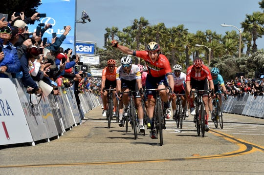 Ivan Cortina raises his fist in victory as he finishes the fifth stage in Ventura during the men's race of the last year's Amgen Tour of California.