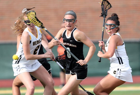 From left, Lakeland's Emma Halderman and Emily Kness (6) battle for a loose ball with White Plains' Alexa Donahue (8) during girls lacrosse playoff action at Lakeland High School in Shrub Oak May 16, 2019. Lakeland won the game 12-9.
