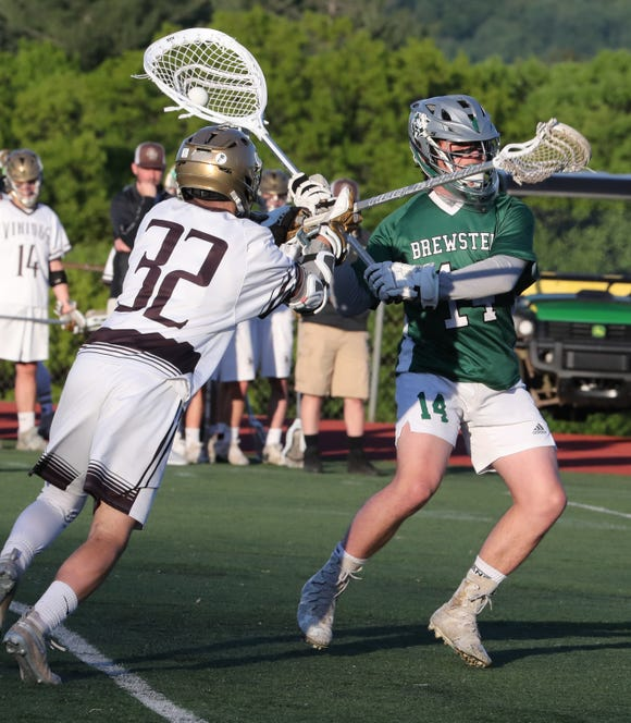 Clarkstown South's Jason Beddows pressures Brewster goalie Will Finn during their Section 1 Class B boys lacrosse opening-round game at Clarkstown South  May 16, 2019. Brewster won 10-9.