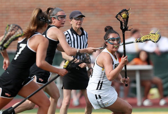 From right, Lakeland's Emily Kness (6) tries to get around White Plains' Alexa Donahue (8) and Julia Reggio (7) during girls lacrosse playoff action at Lakeland High School in Shrub Oak May 16, 2019. Lakeland won the game 12-9.