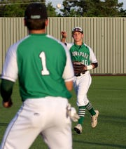 Iowa Park's Braxton Briones throws to first for the out against Decatur in Gm 2 Thursday, May 16, 2019, in Bowie. The Hawks defeated the Eagles 3-2 in Gm 2 and 6-2 in Gm 1 to sweep the series and move on to the Region I-4A semifinals.