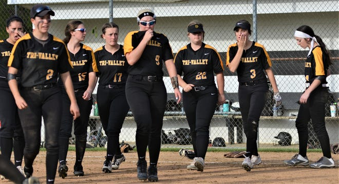 Tri-Valley players walk off the field after losing 5-2 to River View in Thursday's Division II district final at Ridgewood.