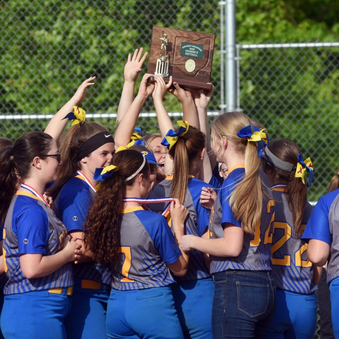 Philo softball players hold up the district championship trophy after a 15-2 mercy of Steubenville on Thursday in Old Washington.