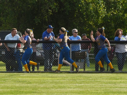 Fans congratulate Philo players after they won a Division II district title with a 15-2 mercy in five innings against Steubenville on Thursday in Old Washington.
