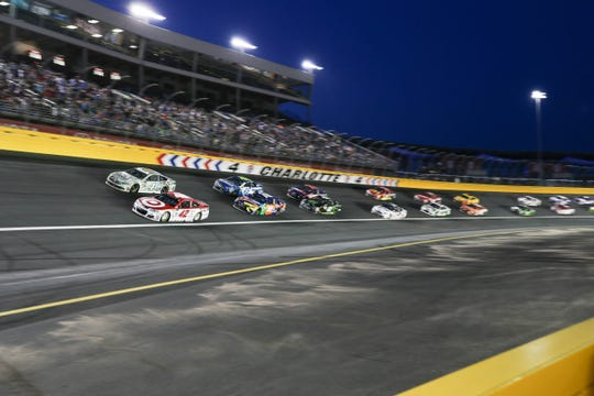 Kyle Larson (42) and Kevin Harvick (4) lead the pack out of Turn 4 during the Monster Energy NASCAR All-Star Race.