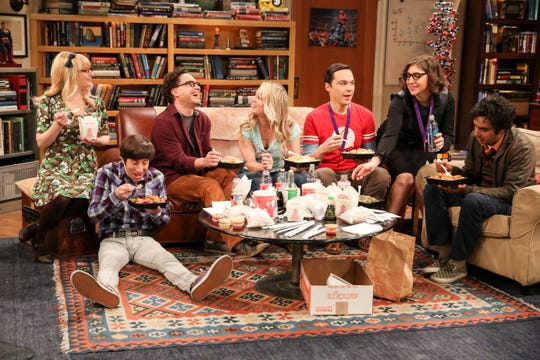 "Sheldon (Jim Parsons), third from left, is happy in his usual couch spot on ""The Big Bang Theory."""