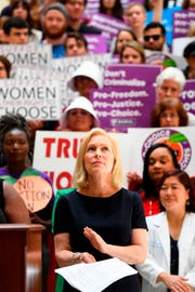 "Democratic presidential candidate Sen. Kirsten Gillibrand (D-NY) attends an event at the Georgia State Capitol to speak out against the recently passed ""heartbeat"" bill on May 16, 2019 in Atlanta, Georgia. - The bill, which bans abortions after a fetal heartbeat is detected around six weeks, was signed on May 15 by Alabama Governor Kay Ivey. Under the new measure, expected to come into effect in six months, performing an abortion is a crime that could land doctors in prison for up to 99 years."