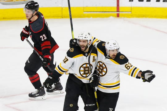Boston Bruins center Patrice Bergeron (37) celebrates with winger Brad Marchand after scoring a goal in the second period of Game 4.