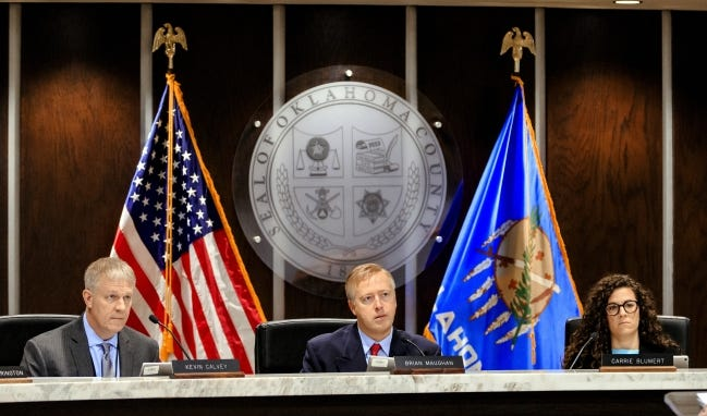 Oklahoma County Commissioners are, from left, Kevin Calvey, Brian Maughan and Carrie Blumert. They voted 2-1, with Calvey dissenting, to provide $15 million in federal coronavirus relief funds to small businesses and nonprofits impacted by the COVID pandemic.  [Chris Landsberger, The Oklahoman Archives]