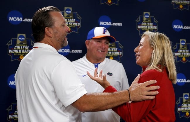 OSU coach Kenny Gajewski, Florida coach Tim Walton and OU coach Patty Gasso talk following a press conference before the Women's College World Series on May 29, 2019. All three are preseason top-10 teams this season. [Sarah Phipps/The Oklahoman]