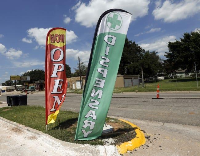 Banners advertise an Oklahoma City marijuana dispensary. [The Oklahoman Archives]