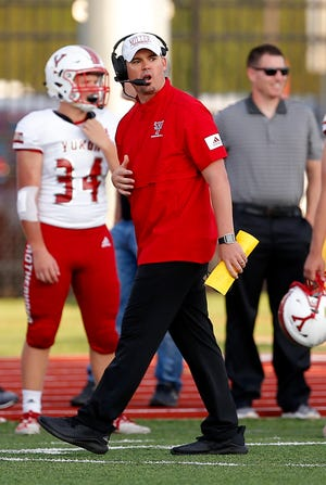 Yukon's Jeremy Reed coaches during the high school football game between Edmond North and Yukon at Edmond North High School in Edmond, Okla., Friday, Aug. 30, 2019. [Photo by Sarah Phipps/The Oklahoman]