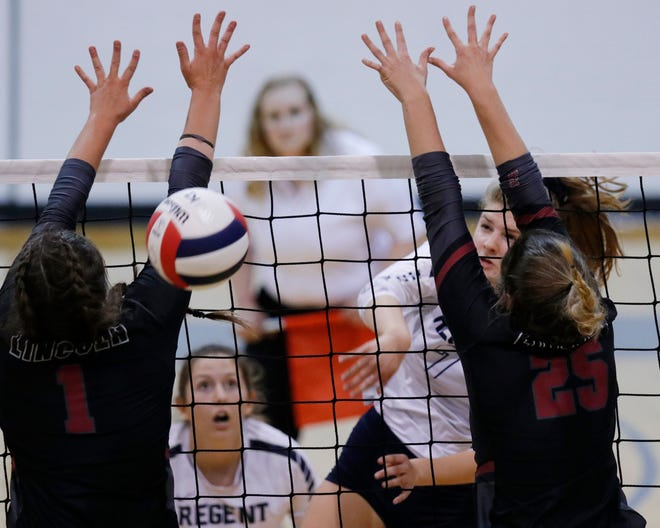 RP #7 Ella Drake gets a hit past LC #1 Jordan Riley and #25 Bayleigh Cox during the high school volleyball 4A championship at Shawnee High School between Regent Prep and Lincoln Christian, Saturday, October 12, 2019. [Doug Hoke/The Oklahoman]
