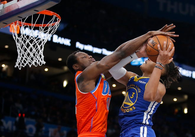 Oklahoma City's Deonte Burton (30) defends against Golden State's Jordan Poole (3) as he goes to the basket during the NBA game between the Oklahoma City Thunder and Golden State Warriors at Chesapeake Energy Arena, Sunday, Oct. 27, 2019. Thunder won 120-92.[Sarah Phipps/The Oklahoman]